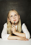 Pupil thinking in classroom, education Stock Photo