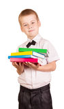 The pupil on white background holds pile of books. The student on a white background holds a pile of books Stock Image