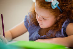 Pupil working hard at desk Royalty Free Stock Images