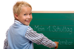 Pupil writes happy on chalkboard Royalty Free Stock Photography