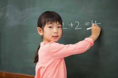 Pupil writing numbers on a blackboard Royalty Free Stock Images