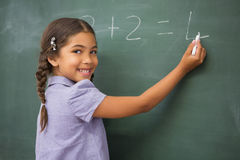 Pupil writing numbers on a blackboard Stock Photography