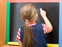 Pupil wrote in chalk on a blackboard ten digit Stock Image