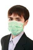 Pupila en una máscara médica Imagenes de archivo