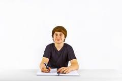 Pupila que hace la preparación para la escuela Imagen de archivo