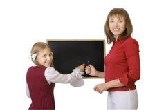 Pupila y profesor imagen de archivo