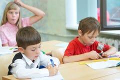 Pupilas en una clase Fotografía de archivo