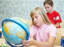 Pupilas en una clase. Imagen de archivo