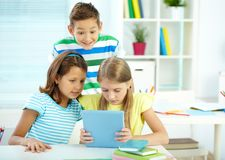 Pupilas na lição Imagem de Stock
