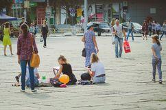 Pupils of the art school draws in the city park in an open air in honor of the city`s day. royalty free stock photos