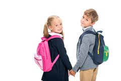 Pupils with backpacks looking back. Adorable little pupils with backpacks looking back isolated on white Stock Photography