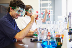 Pupils Carrying Out Experiment In Science Class. Using Scientific Equipment Royalty Free Stock Photo