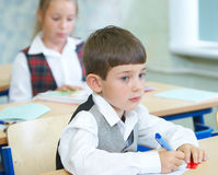 Pupils in a class. A girl and the boy in a class royalty free stock photography