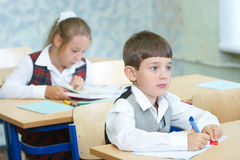 Pupils in a class. The boy and the girl in a class stock photo