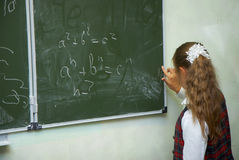 Pupils in a class. The pupil writes on a board royalty free stock image