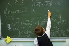 Pupils in a class. The pupil writes on a board Royalty Free Stock Photography