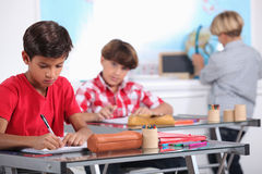 Pupils in class Royalty Free Stock Images