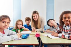 Pupils in a class of a primary school royalty free stock photography