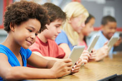 Pupils In Class Using Digital Tablet Royalty Free Stock Photos