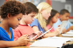 Pupils In Class Using Digital Tablet Royalty Free Stock Photography