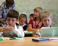 Pupils at classroom Stock Photo