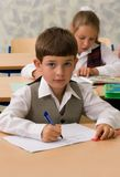 Pupils at classroom Royalty Free Stock Photos