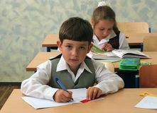 Pupils at classroom Stock Photos