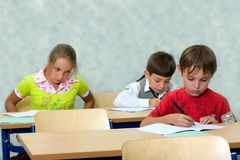 Pupils at classroom Stock Photography