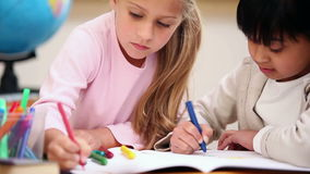 Pupils coloring together Royalty Free Stock Image