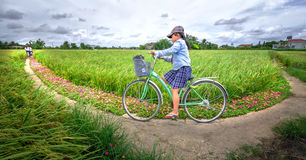 Pupils cycling to school on dirt roads Royalty Free Stock Image