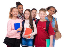 Pupils with different complexion and clothes. Isolated on white background stock photo