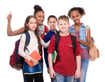 Pupils with different complexion and clothes. Isolated on white background royalty free stock photo