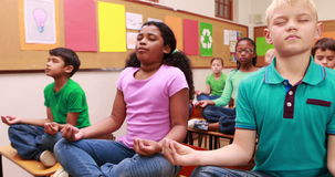 Pupils doing yoga in classroom. At the elementary school stock footage