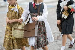 Asti, Italy - September 10, 2017. Pupils dressed in vintage floral dresses and shoulders go to school Stock Photography