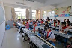 Pupils on electronic organ lesson Stock Image