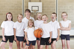 Pupils In Elementary School Basketball Team Stock Photo