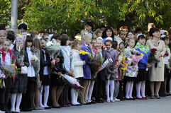Pupils of elementary school on a solemn ruler on September 1 in Royalty Free Stock Images