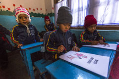 Pupils in English class at primary school. Only 50% of  children in Nepal can reach 5 grade. Stock Image