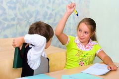Pupils fight at lesson. Elementary school. Pupils fight at lesson stock image
