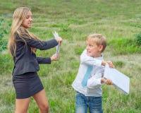 Pupils fight notebooks Stock Photo
