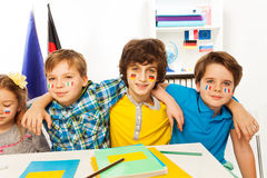 Pupils with flags on cheeks learning languages Stock Photography
