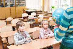 Pupils at a geography lesson Royalty Free Stock Image