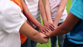 Pupils holding hands together and cheering outside. Pupils holding hands together and cheering at the elementary school stock video footage