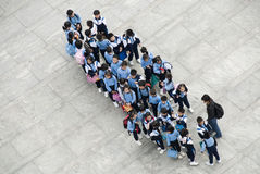 Pupils in Hong Kong. Birdsview of class of pupils in school uniforms on a trip to the Hong Kong peak Royalty Free Stock Photography