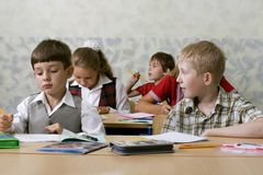 Pupils at lesson. Image about pupils at lesson at classroom Royalty Free Stock Photo