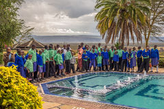 Pupils lined up in blue school uniforms near lake Nakuru, Kenya Stock Image