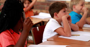 Pupils listening attentively during class. In elementary school stock footage