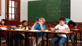 Pupils listening to teacher during class. In elementary school stock footage