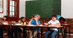 Pupils listening to teacher during class. In elementary school stock video