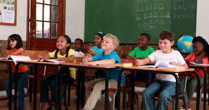 Pupils listening and writing during class. In elementary school stock video